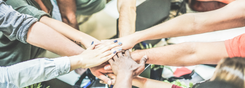 Work team stacking hands together for new startup project - Diverse culture people giving strength motivation to each others - Focus on blue nails woman hand - Power and human strongness concept